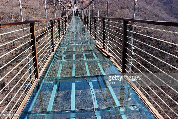 Glass suspension bridge is seen to be completed totally at Fuxishan Tourism Resort on January 26, 2016 in Zhengzhou, Henan Province of China. The...