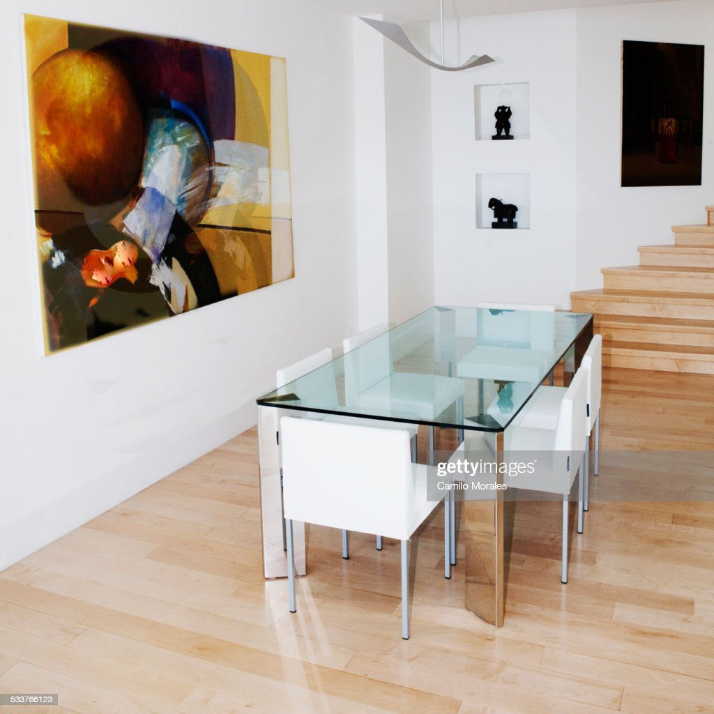 Glass table and chairs in dining room : Foto stock