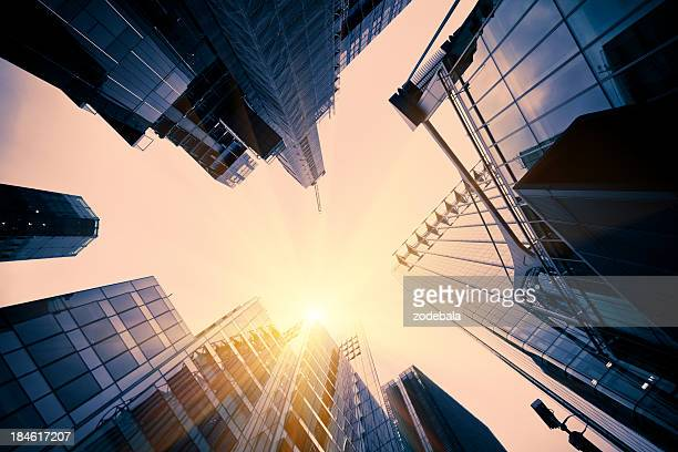 glass tall buildings in financial district - canary wharf stock photos and pictures