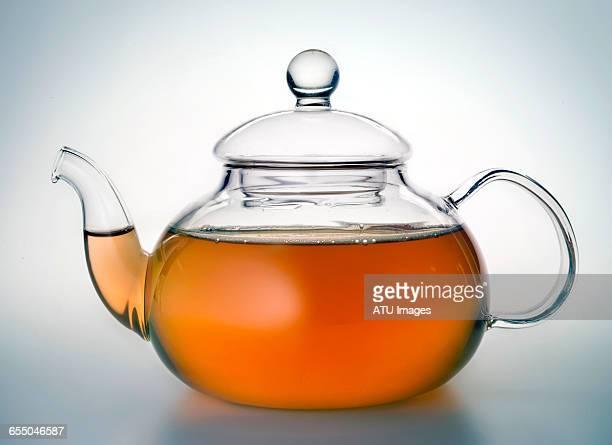 glass tea pot - ティーポット ストックフォトと画像