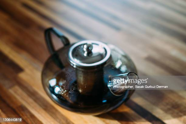 glass teapot full of tea - english teapot stock pictures, royalty-free photos & images
