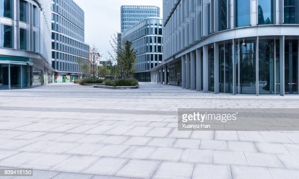 glass wall with reflection of modern buildings in midtown of beijing , auto advertising background - städtischer platz stock-fotos und bilder