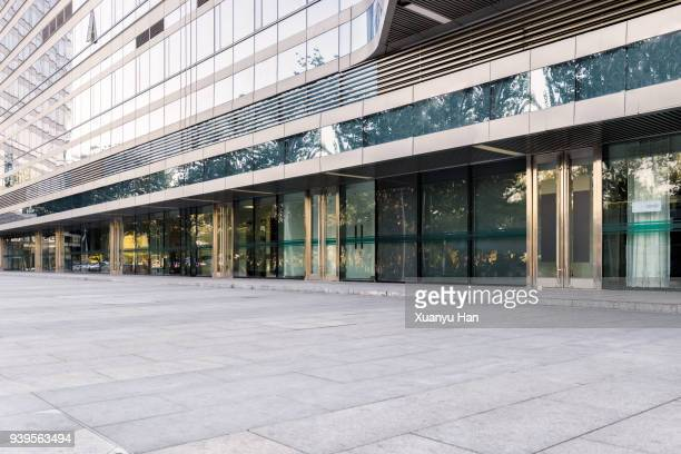 glass wall with reflection of modern buildings in midtown of beijing , auto advertising background - bankenviertel stock-fotos und bilder