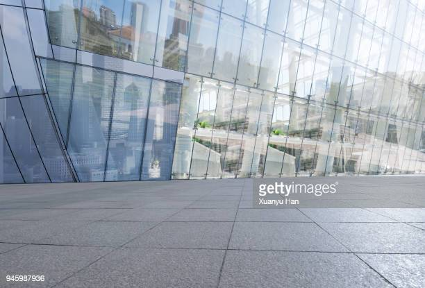 glass wall with reflection of modern buildings in midtown of tianjin - gebäudefront stock-fotos und bilder
