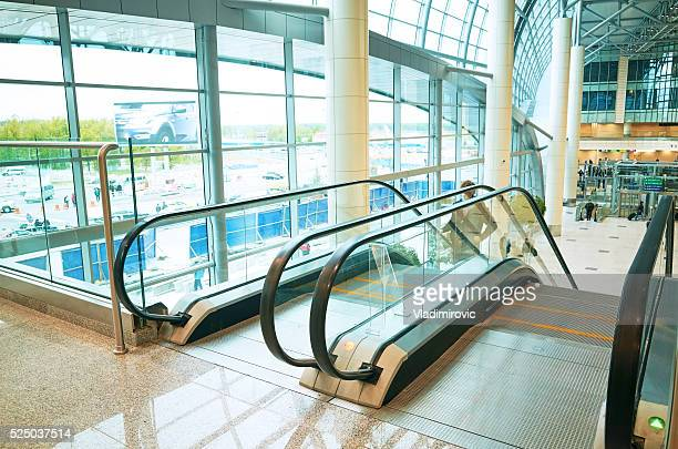 Glass window floor escalator people in modern office building