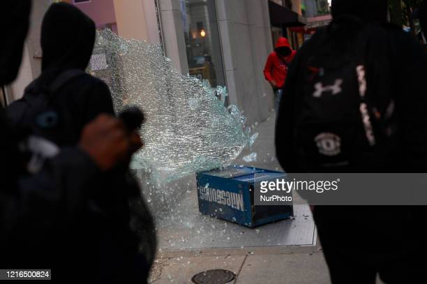A glass window shattered from vandalism after protest turn violent in Philadelphia PA on May 30 2020 Protestors clash with police in cities around...
