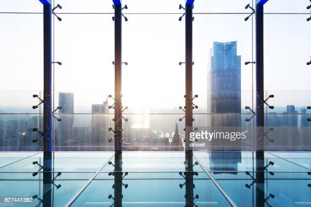 glass window with modern buildings in midtown of modern city