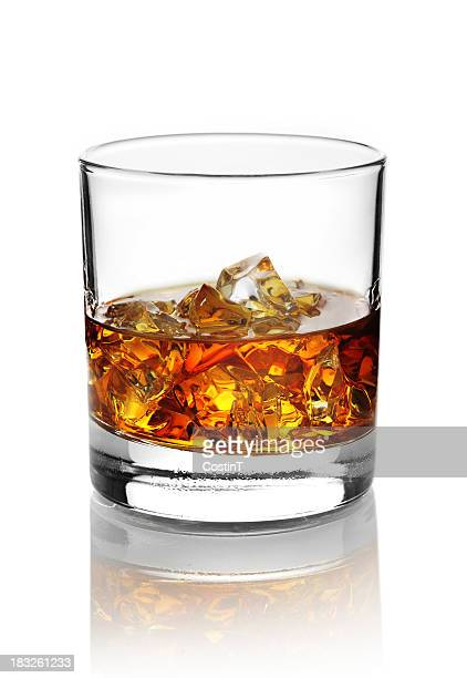 Glass with alcohol and ice cubes.