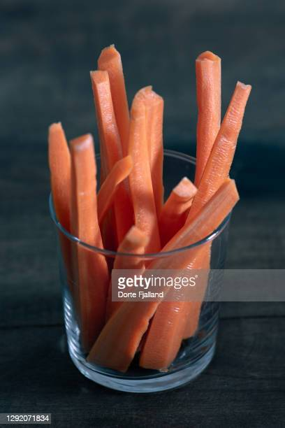 a glass with sticks of carrots - dorte fjalland fotografías e imágenes de stock