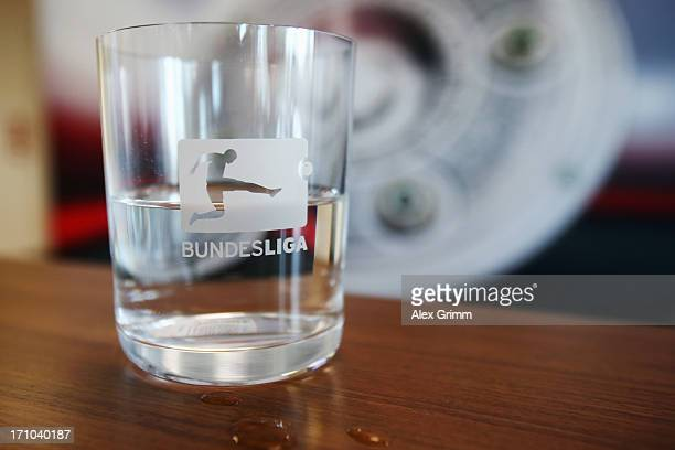 A glass with the Bundesliga logo is seen during a press conference at the DFL headquarters on June 21 2013 in Frankfurt am Main Germany