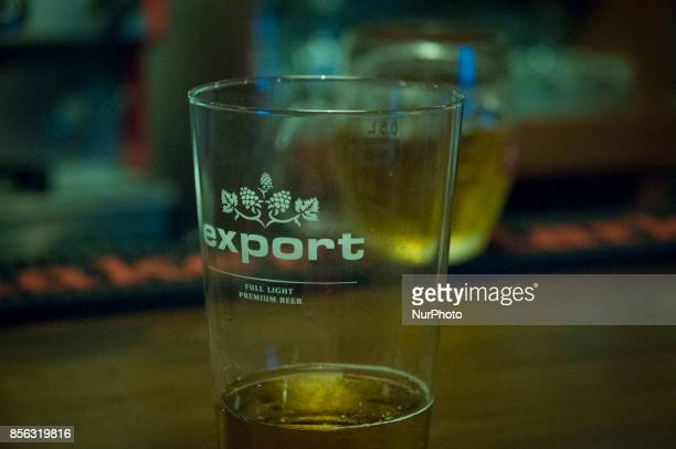 A glass with the logo for the Perla export brand beer is seen in a jazz club on September 29 2017 Perla is the largest domestic beer brand in Poland