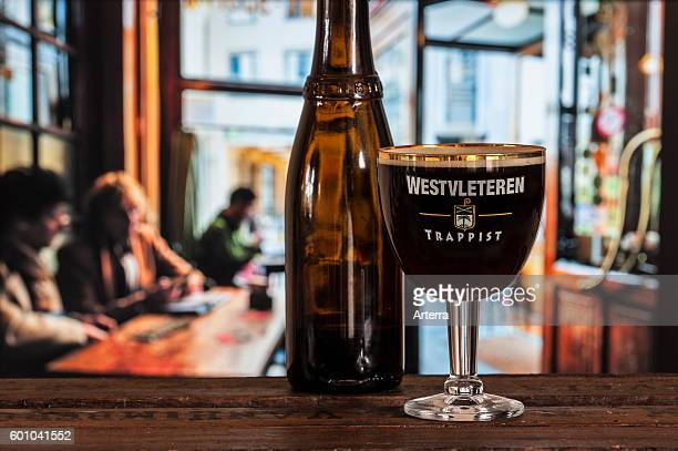 Glass with trappist Westvleteren best beer in the world brewed in the SintSixtusabdij / Abbey of Saint Sixtus served in cafe in Belgium