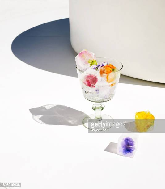 Glass with water and flower ice cubes
