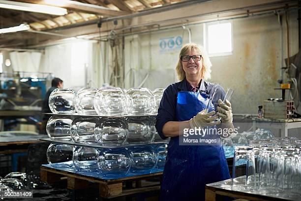 Glass worker holding vase