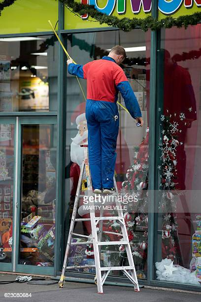A glass worker measures a cracked glass panel in Wellington after a 78 earthquake struck the South Island on November 14th 2016 At least two people...