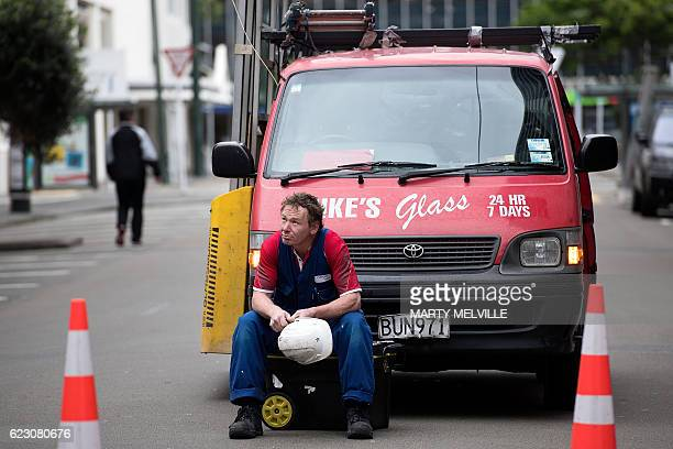 A glass worker waits for the all clear to start work on replacing broken glass in Wellington after a 78 earthquake struck the South Island on...
