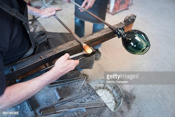 glassblower forming hot glass - blowpipe stock pictures, royalty-free photos & images
