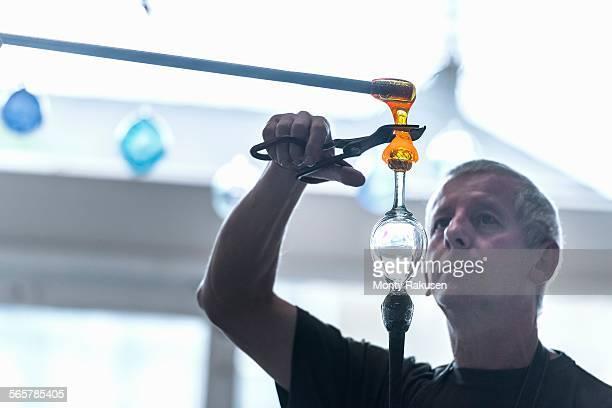 Glassblower forming molten glass