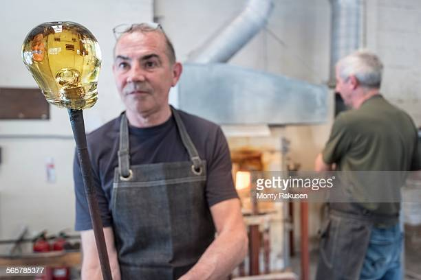 glassblower with large blob of hot glass - blowpipe stock pictures, royalty-free photos & images