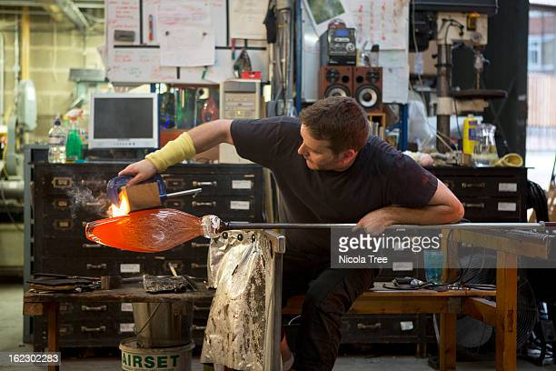 Glassblower working on a large glass sculpture
