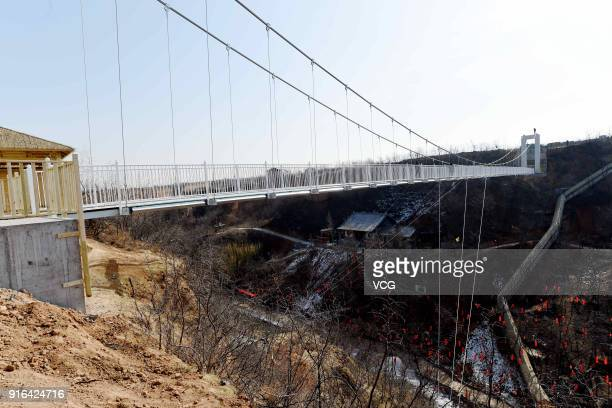 A glassbottomed skywalk is seen at Yibin District on February 7 2018 in Luoyang Henan Province of China The glass walkway stretches 138 meters into...