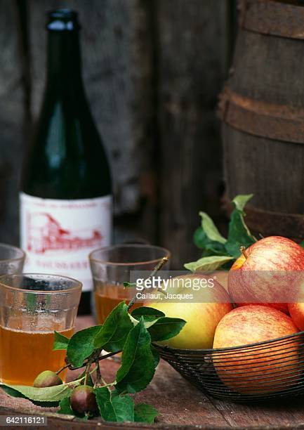 Glasses and bottle of cider