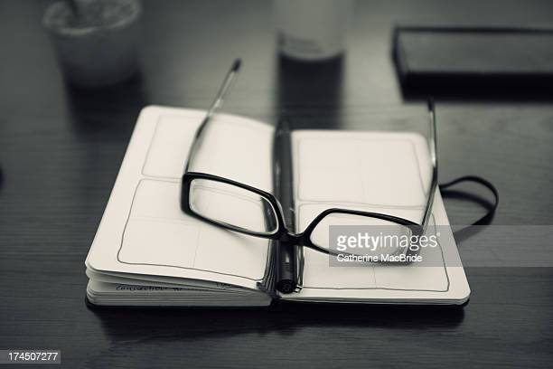glasses and notebook - catherine macbride stock pictures, royalty-free photos & images