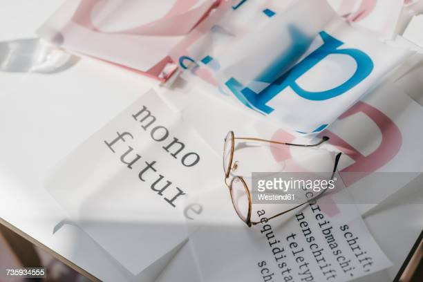 glasses and script templates on table - typography stock photos and pictures