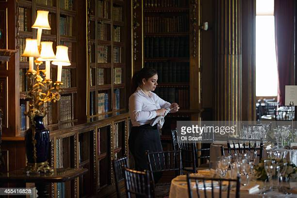 Glasses are cleaned before the Queen Charlotte's Ball at Highclere Castle on September 13, 2014 near Newbury, England. Queen Charlotte's Ball is the...