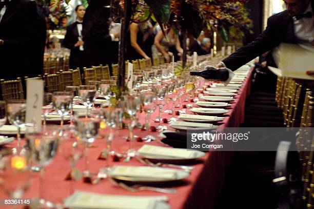 Glasses are filled at the Frick Collection Autumn dinner at The Frick Collection on October 20 2008 in New York City