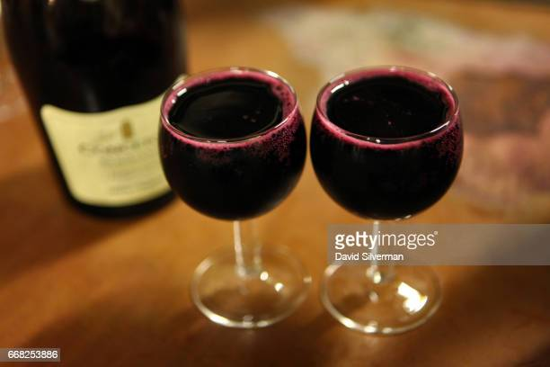Glasses are filled to the brim with Medici Ermete Concerto Lambrusco Reggiano a local ruby red sparkling wine made with Lambrusco Salamino grapes at...