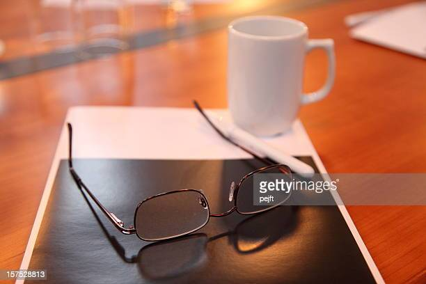 glasses at a conference table - pejft stock pictures, royalty-free photos & images
