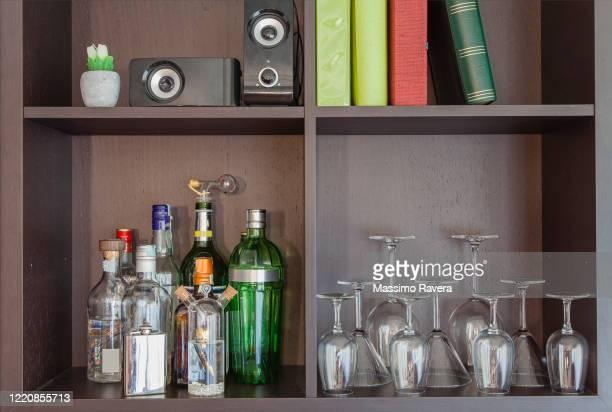 glasses, drinks, music and books - キャビネット ストックフォトと画像