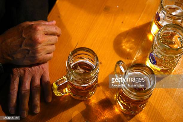 Glasses filled with different Oktoberfest beers stand on a table among the heads of the six Munich breweries meeting to taste their special...