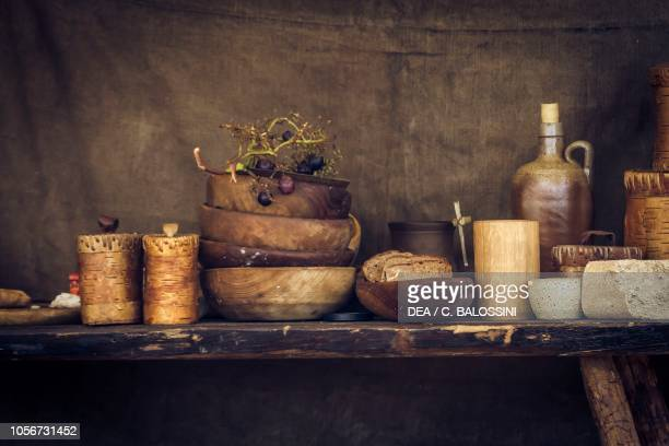 Glasses flask and wooden bowls Festival of Slavs and Vikings Centre of Slavs and Vikings JomsborgVineta Wolin island Poland Slavic and Viking...