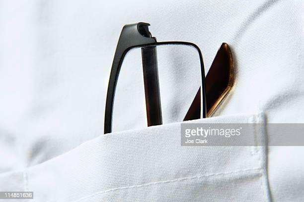 Glasses in pocket of doctors coat