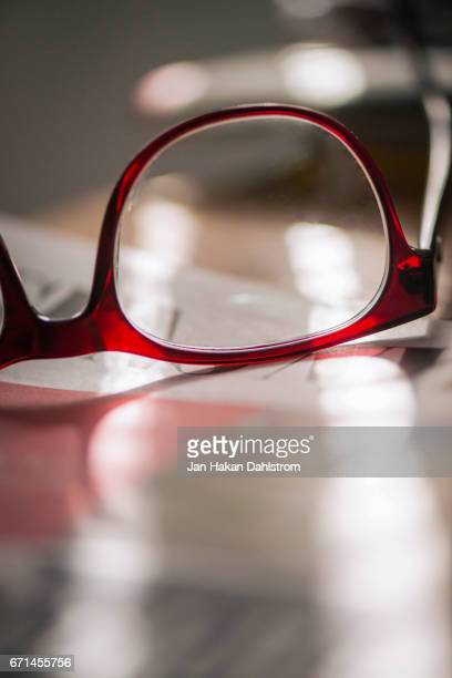 Glasses in sunbeam on newspaper