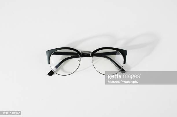 glasses in white background - eyeglasses stock pictures, royalty-free photos & images