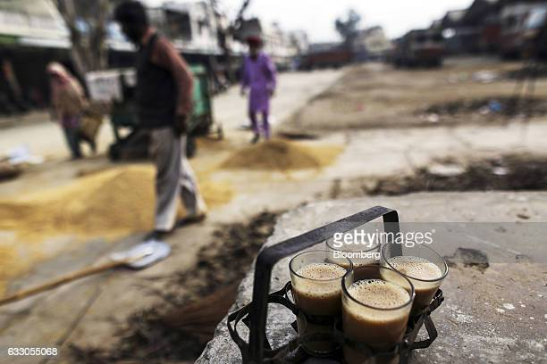 Glasses of chai sit in a rack at an Agricultural Produce Market Committee wholesale market in Jalandhar Punjab India on Saturday Jan 21 2017 Indias...