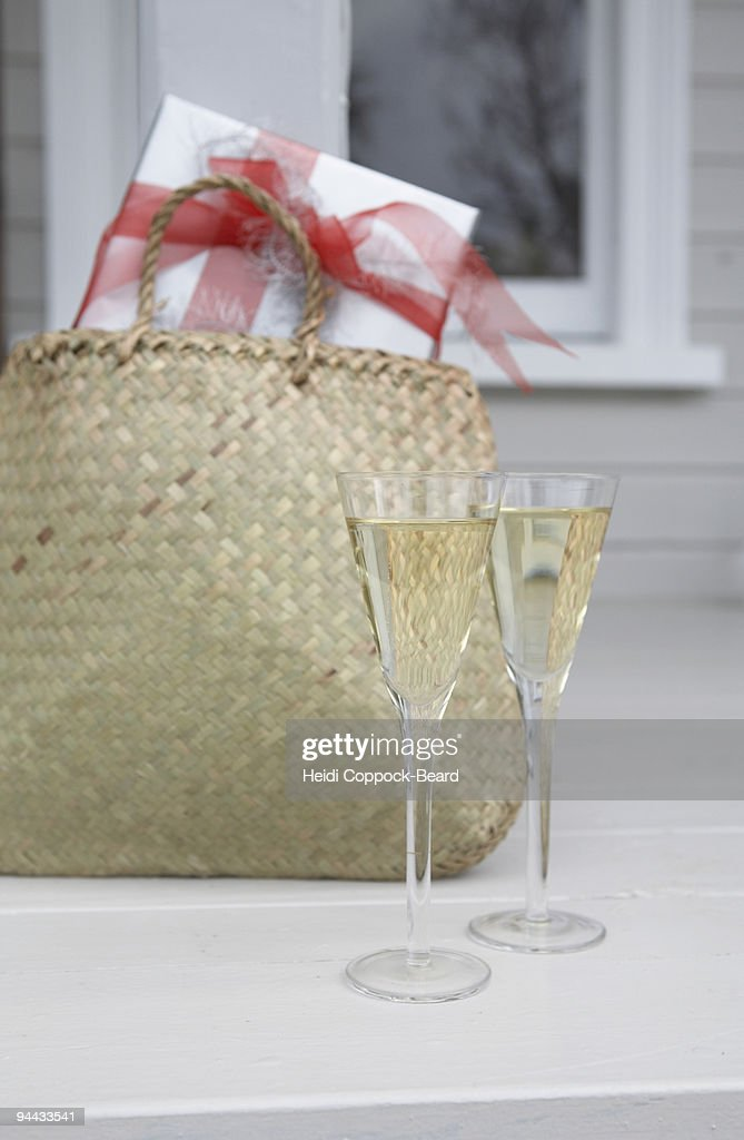 Glasses of Champagne and present : Stock Photo
