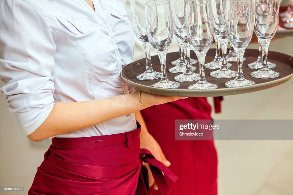 glasses of champagne on tray : Bildbanksbilder