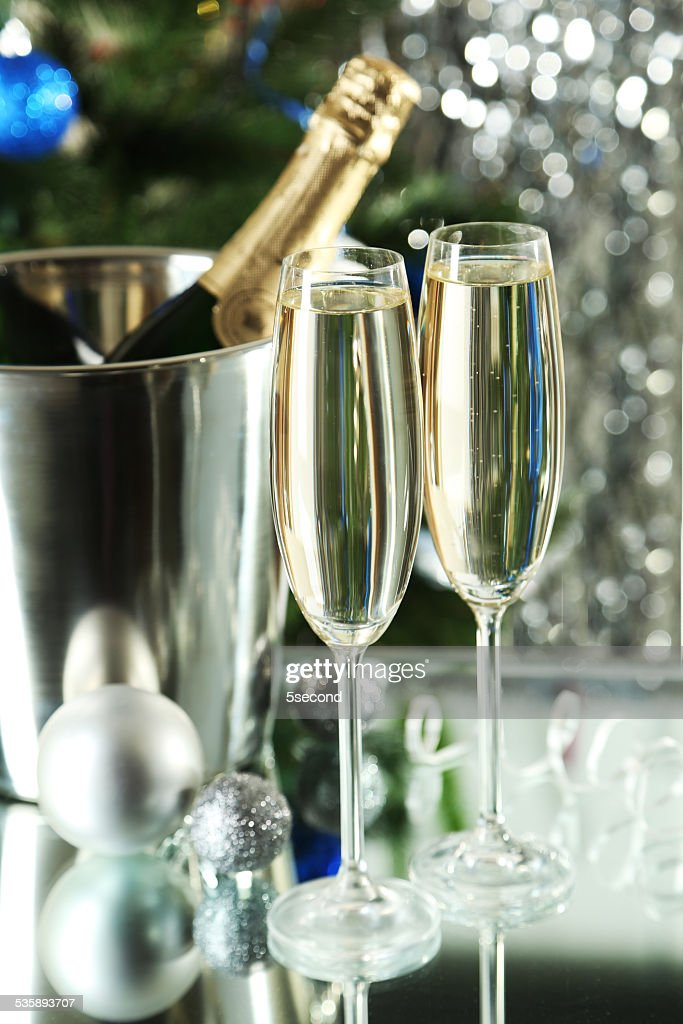 Glasses of champagne with bottle in a bucket on background : Stock Photo