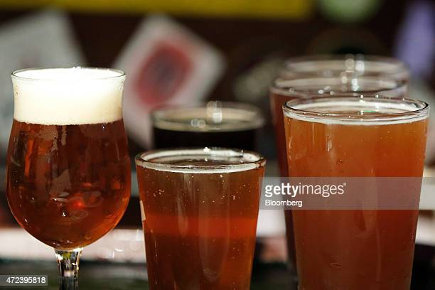 Glasses of craft beer sit ready to be served inside the Bakusyu Club Popeye bar in the Ryogoku neighborhood of Tokyo Japan on Friday May 1 2015 Craft...