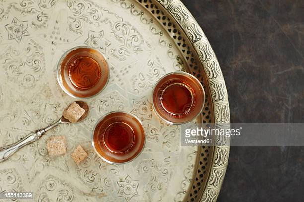 Glasses of Earl Grey tea on plate, close up