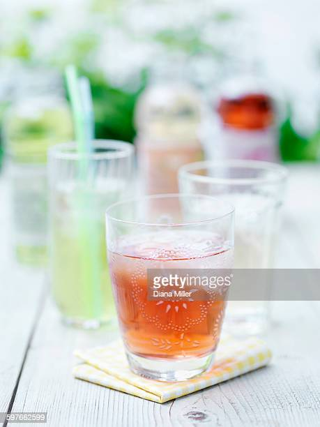 Glasses of fresh fruit teas and ice