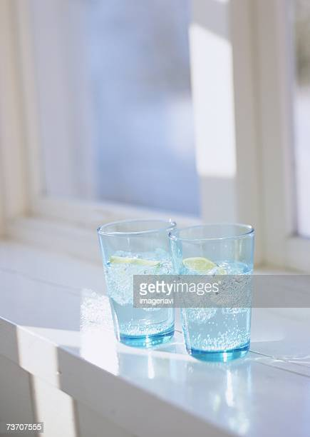 Glasses of Lime water on windowsill
