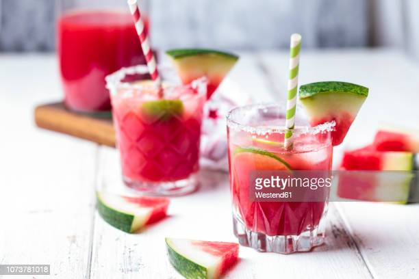 glasses of melon margarita with watermelon juice - margarita stock pictures, royalty-free photos & images