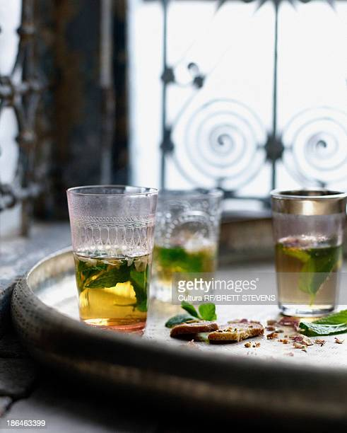 Glasses of Moroccan mint tea with pistachio biscuits