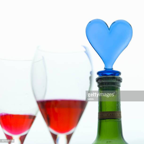 glasses of red wine and wine bottle - bottle stopper stock photos and pictures