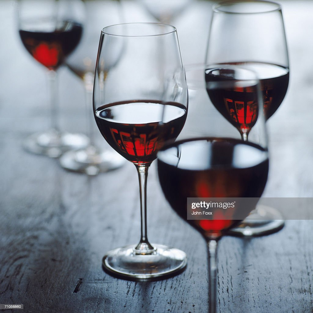Glasses of red wine, close-up : Stock Photo